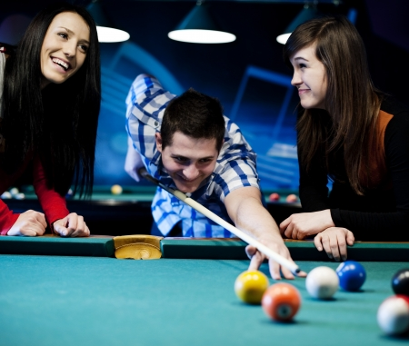 pool table: Friends playing billiard