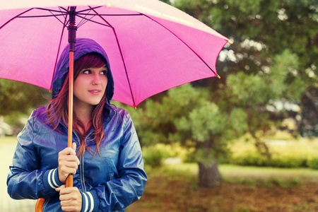 woman umbrella: Walking through rain