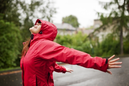 Female enjoying rain photo