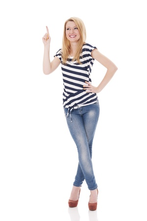 Happy woman in striped blouse pointing at copyspace photo