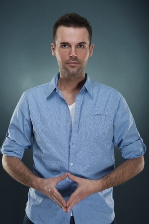 Confident handsome man in blue shirt Stock Photo - 18191019