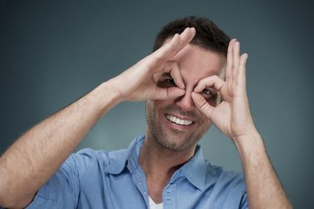 Cheerful man making hand gesture Stock Photo - 18190967