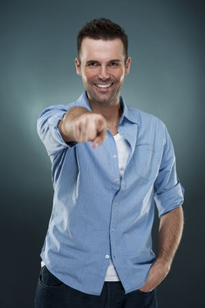 Mature man pointing at you photo