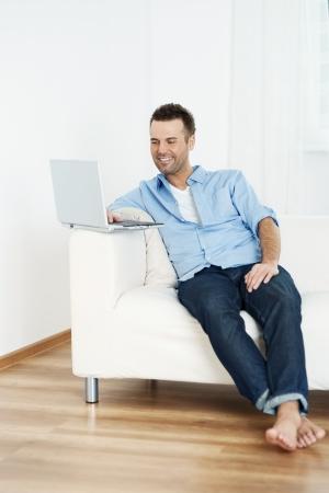 barefoot man: Surfing the net Stock Photo