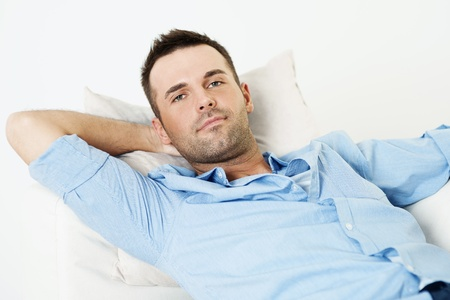hands behind back: Handsome man relaxing with hand behind head Stock Photo