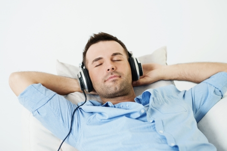 listening back: Dreaming man listening to music Stock Photo