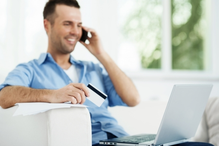 Attractive male paying bills photo