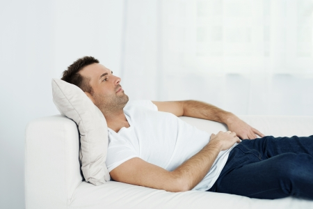Mature man relaxing on sofa Stock Photo
