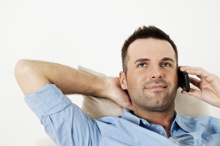 stubble: Handsome man using smart phone Stock Photo
