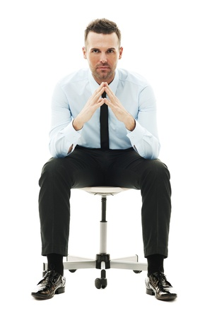 man front view: Serious businessman sitting on chair