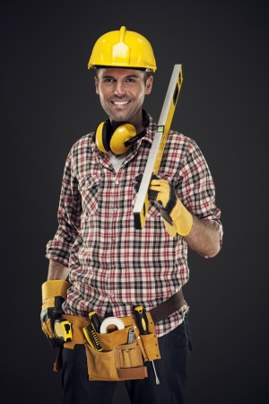 three people only: Smiling construction worker holding measuring Stock Photo