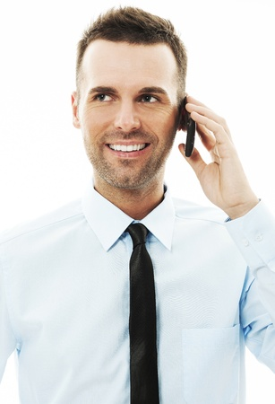 Handsome businessman talking on mobile phone photo