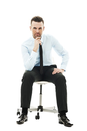 new thinking: Pensive businessman sitting on chair
