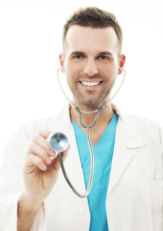 listening to heartbeat: Cheerful doctor with stethoscope