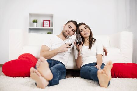 Romantic couple drinking wine at home Stock Photo - 18190799