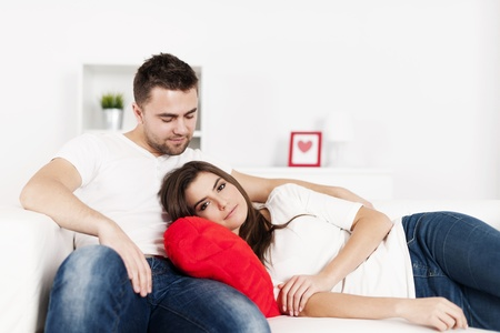 Loving couple resting on couch Stock Photo - 18190765