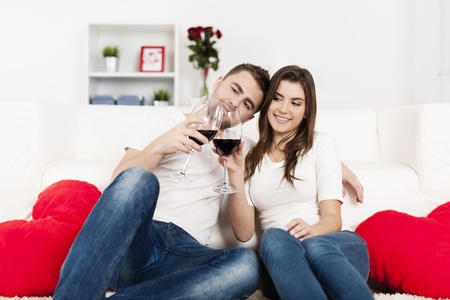 Romantic couple drinking wine at home Stock Photo - 18190738