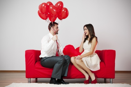 heterosexual couple: Those are the balloons for you Stock Photo