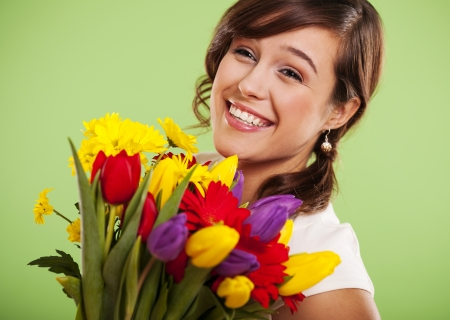 cut flowers: Portrait of a smiling woman with colorful flowers