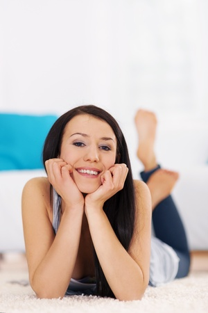 Brunette woman lying down on the carpet Stock Photo - 18208201