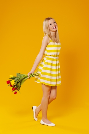 Happy young woman with flowers Stock Photo - 18208282