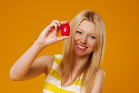 Woman with  red easter egg photo
