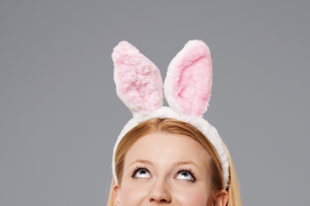 Easter bunny woman looking up