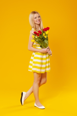 Blonde woman holding bouquet of spring flower photo