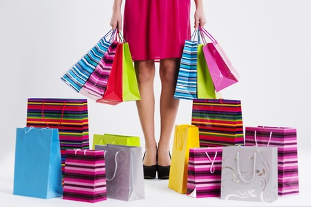 high heel shoes: Woman with full shopping bags