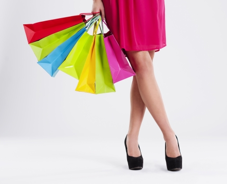 money bags: Low section of a woman with full of shopping bags Stock Photo