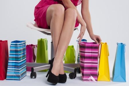Sitting woman checks her shopping Stock Photo - 18282557