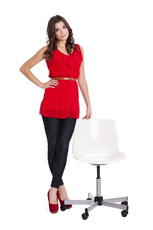 tunic: Fashionable woman standing next to a chair