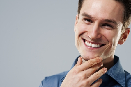 young man portrait: Close-up of smiling man Stock Photo