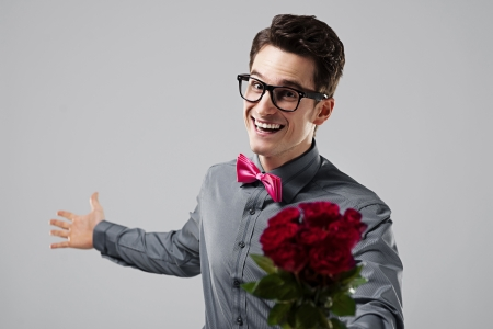 flirting: Cute nerd with a bouquet of roses