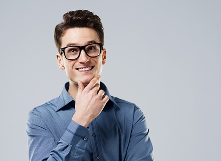 Smart man with glasses looking up photo