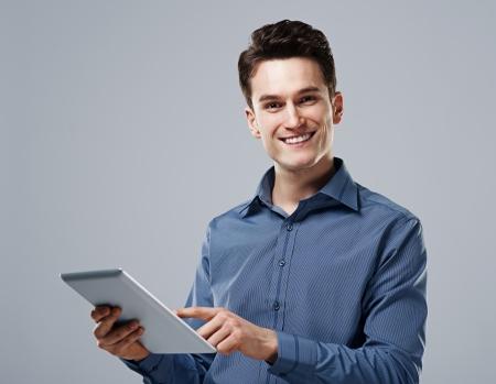Happy man using digital tablet photo