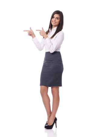 Smiling businesswoman pointing to copy space Stock Photo - 18423956