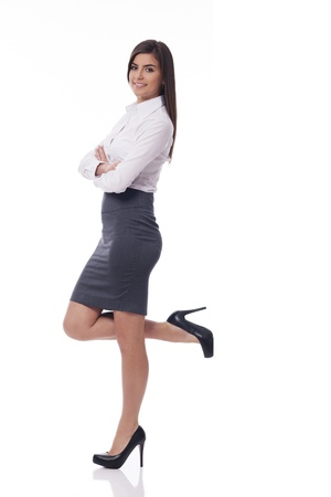 up skirt: Smiling businesswoman leaning on something