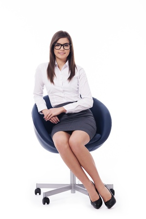businesswoman: Young professional businesswoman sitting on a chair Stock Photo