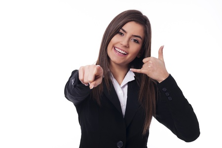 business wear: Cheerful woman gesturing  call me  Stock Photo
