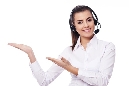 phone support: Smiling woman in headset presentation something Stock Photo