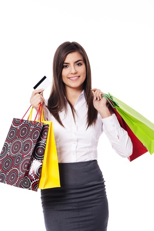 Businesswoman with shopping bag and credit card photo