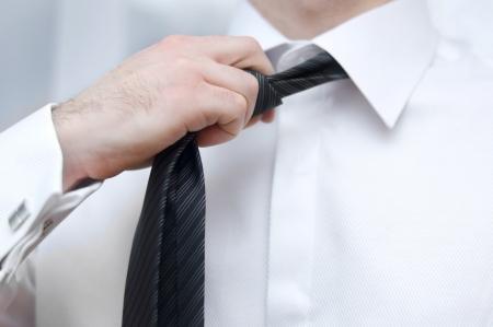 Businessman adjusting tie Stock Photo - 18868608