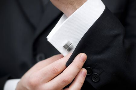 Cuff link, man is getting dressed Stock Photo - 18868612