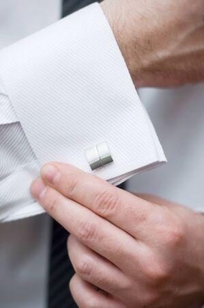 cuff link: Cuff link, man is getting dressed