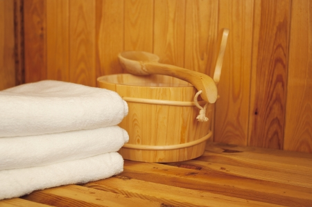 Sauna - Bucket, ladle and towel in sauna Stock Photo - 18868631