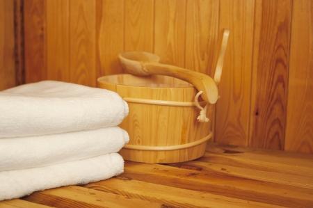 Sauna - Bucket, ladle and towel in sauna Stock Photo - 18868631