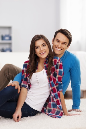 Loving couple in living room  Stock Photo - 18880679