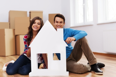 Young couple with house sign Stock Photo - 18880683