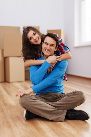 Happy couple in their new house Stock Photo - 18880686